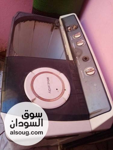 مغسله ملابس بخاريه تتكون من مكوه بخاريه وغساله LG ومكيف ومروحه - صورة رقم