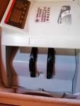 ماكينة كهربائيةلحساب (عد) النقود