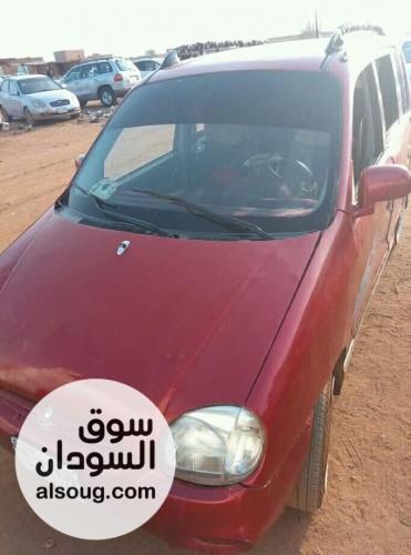 سياره اتوز حمراء موديل 99 صالون - صورة رقم