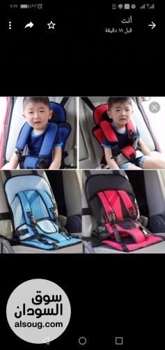 مقعد وحزام تثبيت الطفل في السياره - صورة رقم