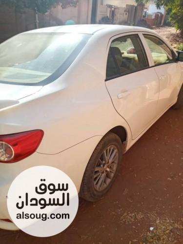 سيارة كوريلا للبيع ٢٠١٣ بيضاء. - Image #
